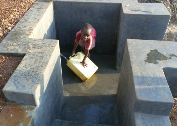 Apio Racheal finds it exciting to fetch water from the New spring well.She is 9 yrs